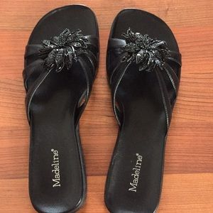 Black sandals with flower on top
